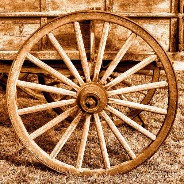 Wall Art - Photograph - Old Prairie Schooner Wheel - Sepia by Olivier Le Queinec