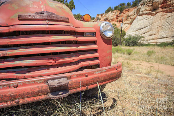 Wall Art - Photograph - Old Red Chevrolet Outside Zion National Park Utah by Edward Fielding