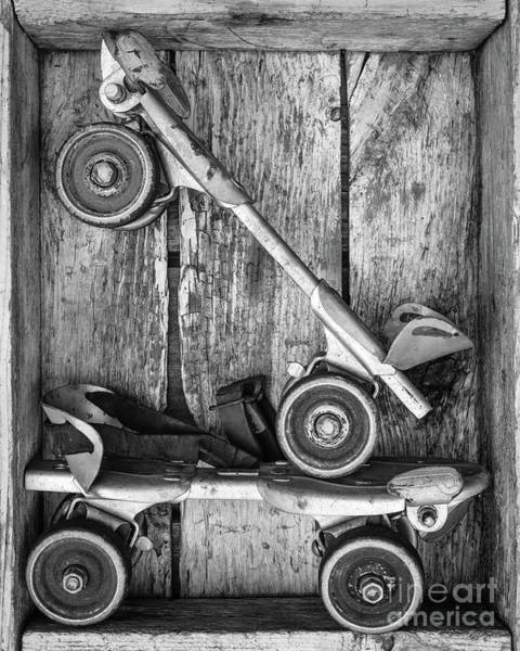 Photograph - Old Roller Skates Black And White by Edward Fielding