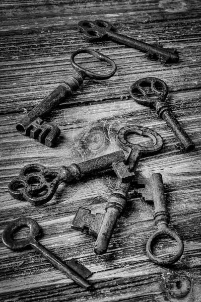 Wall Art - Photograph - Old Rusty Black And White Skeleton Keys by Garry Gay