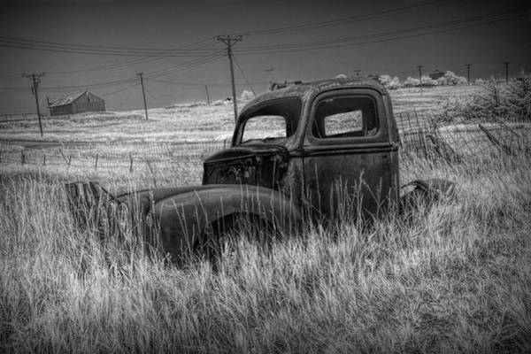 Photograph - Old Truck Abandoned In The Grass In Infrared Black And White At The Ghost Town By Okaton South Dakot by Randall Nyhof