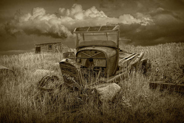 Photograph - Old Truck Abandoned In The Grass In Sepia Tone by Randall Nyhof