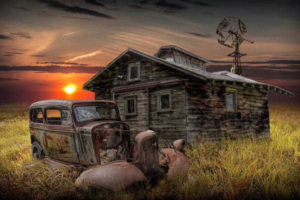 Photograph - Old Vintage Abandoned Automobile With Rustic Building And Windmill by Randall Nyhof