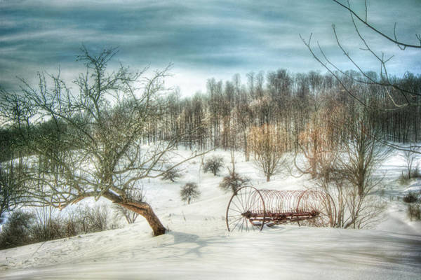 Photograph - Old Wheel On Snow Covered Field by Joann Vitali