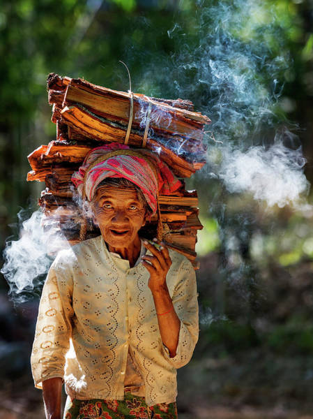 Photograph - Old Woman Carrying Wood-logs On Her Head by Pradeep Raja PRINTS