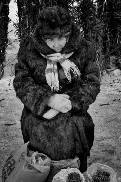 Photograph - Old Woman In Fur Selling Berries In Winter by John Williams