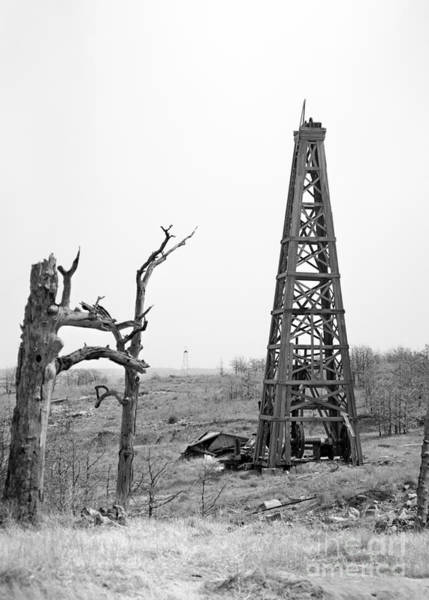 Oil Pump Photograph - Old Wooden Oil Derrick by Larry Keahey