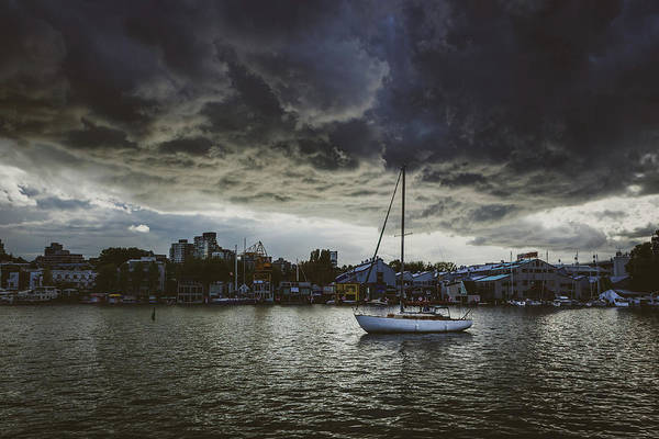 Photograph - Ominous Clouds Over Isolated Boat by Andy Konieczny