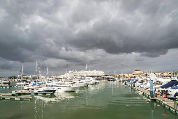 Photograph - Ominous Clouds - Vilamoura Marina In Algarve Portugal by Georgia Mizuleva