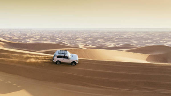 Photograph - One 4x4 Vehicle Off-roading In The Red Sand Dunes Of Dubai Emirates, United Arab Emirates by Alexandre Rotenberg