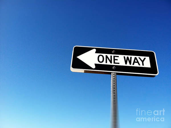 Photograph - One Way Road Sign Against Blue Sky by Bryan Mullennix