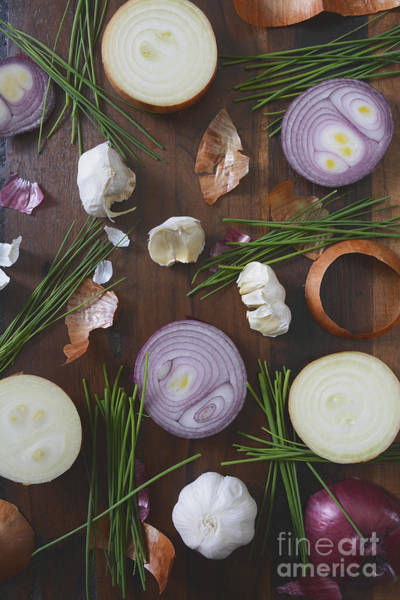 Wall Art - Photograph - Onions Chives And Garlic Scattered On Wood Table by Milleflore Images