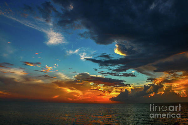 Photograph - Orange And Blue Cloudy Sky by Tom Claud