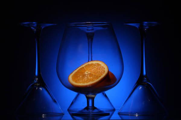 Photograph - Orange In Blue Light  by Dmitry Soloviev
