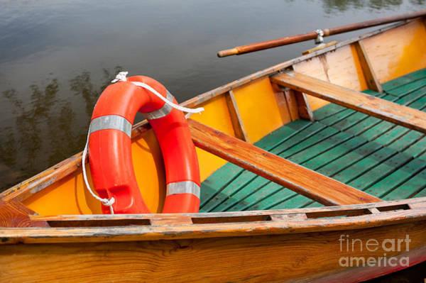 Wall Art - Photograph - Orange Life Belt In Wooden Boat by Arletta Cwalina