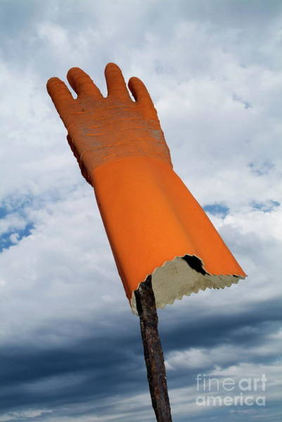 Protective Clothing Wall Art - Photograph - Orange Rubber Glove On A Wooden Post Against A Cloudy Sky by Sami Sarkis