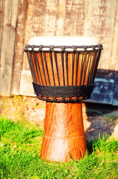 Djembe Wall Art - Photograph - Original African Djembe Drum With Leather Lamina On Green In Sun Light. by Jozef Klopacka