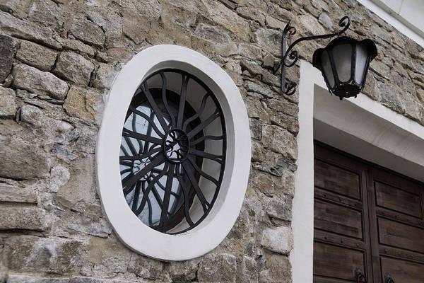 Photograph - Oval Window Reflections - High Garden Wall And Gate by Georgia Mizuleva