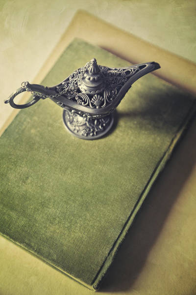 Photograph - Over Head View Of Genie Lamp On A Book by Sandra Cunningham