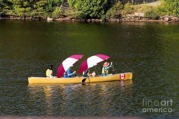Photograph - Paddling Under Umbrellas by Les Palenik