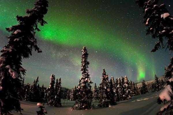 Below Photograph - Painting The Sky With The Northern Lights by Mike Berenson