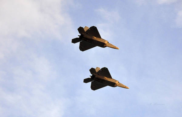 Wall Art - Photograph - Pair Of Lockheed Martin F-22 Raptors On Patrol In Enemy Air Space by L Brown