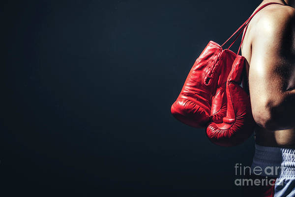Kickboxing Photograph - Pair Of Red Gloves On The Fighter's Back. by Michal Bednarek