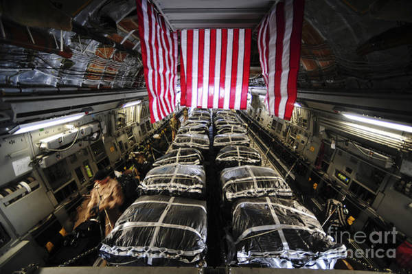 C-17 Photograph - Pallets Of Cargo Inside Of A C-17 by Stocktrek Images