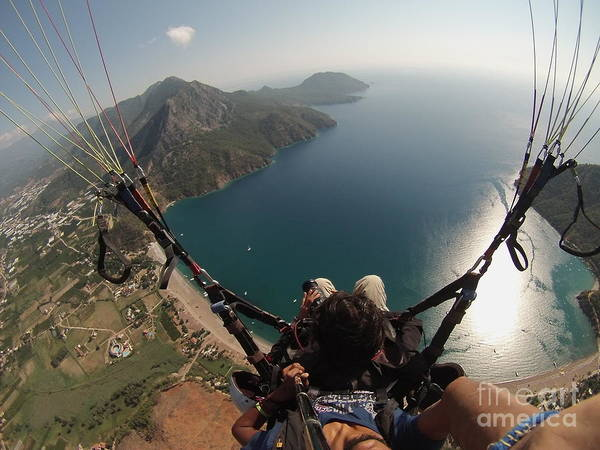 Photograph - Paragliding Fly Above Laguna Seascape by Raimond Klavins