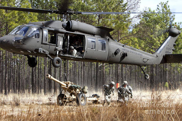 Utility Helicopter Photograph - Paratroopers Connect A Howitzer by Stocktrek Images