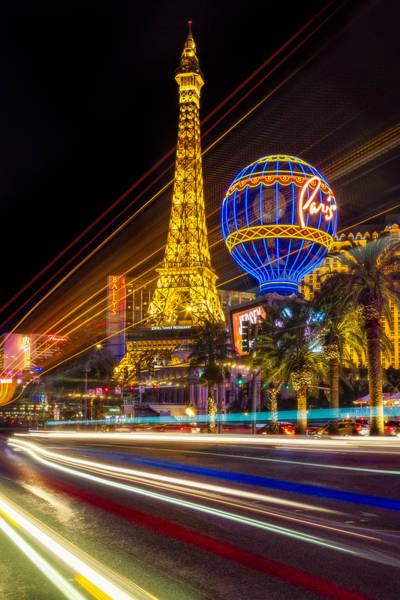 Photograph - Paris In Las Vegas Strip Light Show by Susan Candelario