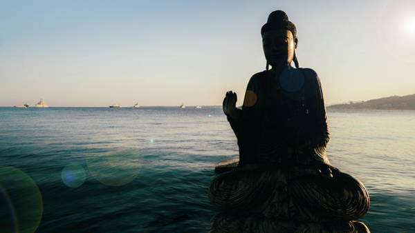 Photograph - Partial Silhouette Of Wooden Buddha In Water by Alexandre Rotenberg