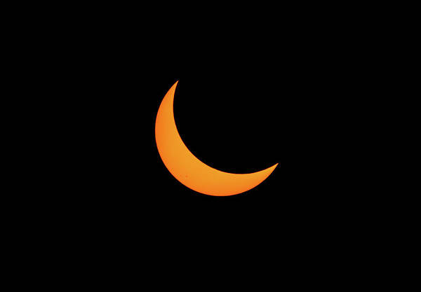 Photograph - Partially Eclipsed Sun by Marc Crumpler