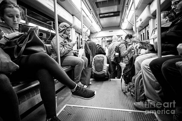 Wall Art - Photograph - passengers on board Boston MBTA underground green line train USA by Joe Fox