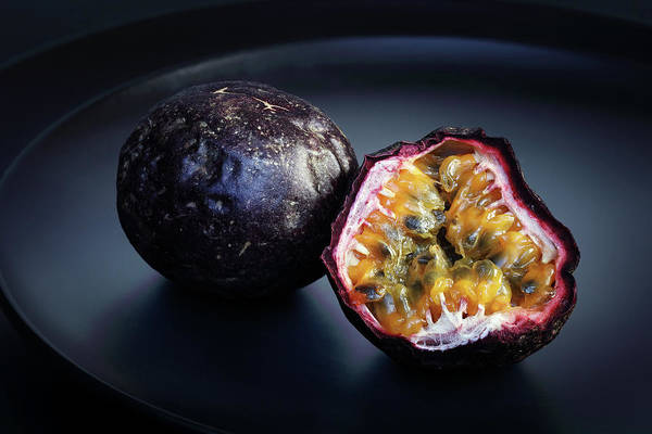 Juicy Fruit Wall Art - Photograph - Passion Fruit On Black Plate by Johan Swanepoel