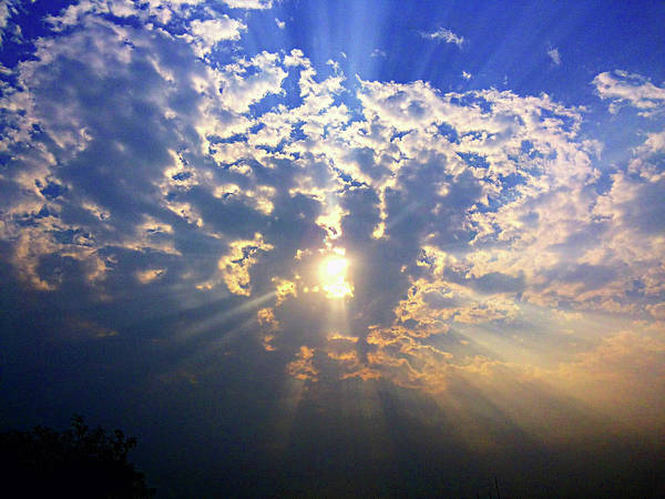 Photograph - Peaking Behind The Clouds by Atullya N Srivastava
