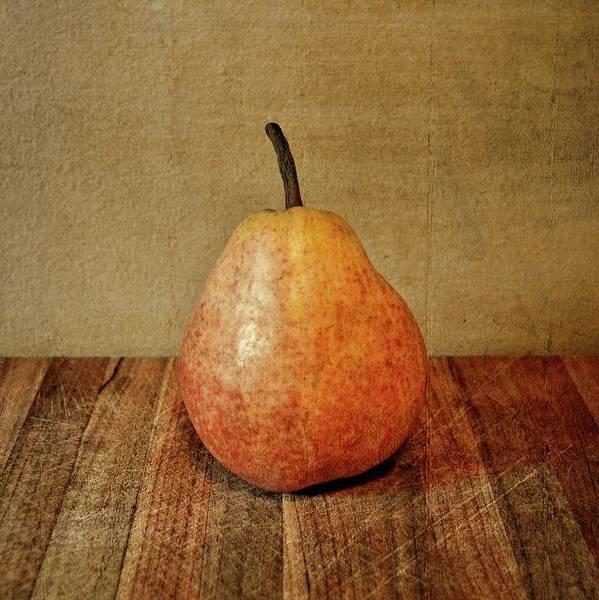 Photograph - Pear On Cutting Board 1.0 by Michelle Calkins