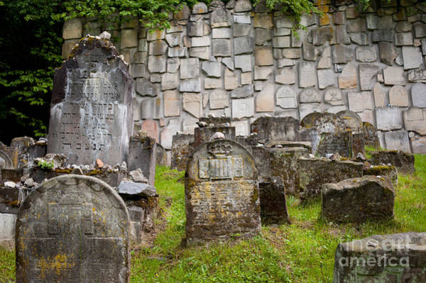 Wall Art - Photograph - Pebbles On Jewish Graves At Cemetery by Arletta Cwalina