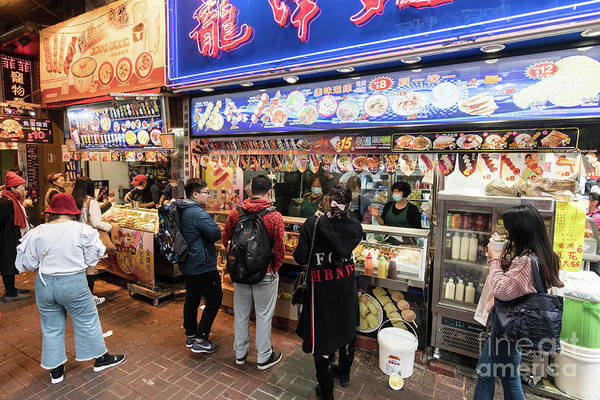 Photograph - People Buy Various Street Food Snacks, Such As Fish And Meat Bal by Didier Marti
