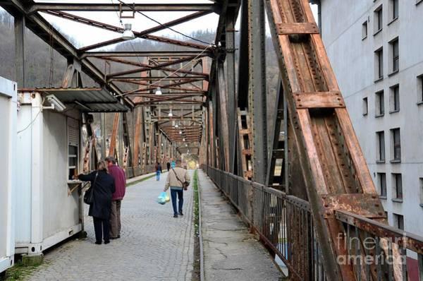 Photograph - People Crossing Old Yugoslav Weathered Metal Bridge Crossing In Bosnia Hercegovina by Imran Ahmed