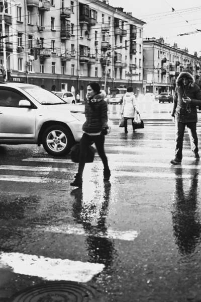 Photograph - People Walk Across A Road In Reflections Of Rain by John Williams