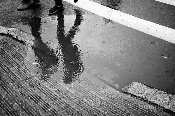 Walking In The Rain Wall Art - Photograph - people walking past rainwater starting to flood on streets New York City USA by Joe Fox