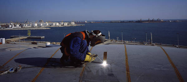 Wall Art - Photograph - Person Welding In A Chemical Plant by Panoramic Images