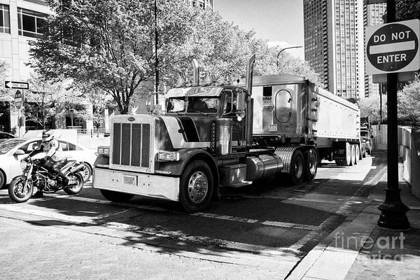 Peterbilt Photograph - peterbilt semi truck hauling cargo through downtown Boston USA by Joe Fox