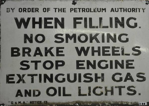 Flammable Wall Art - Photograph - Petrol Sign by Rob Potter