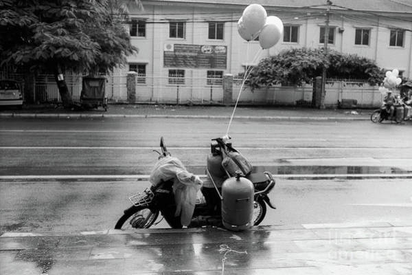 Wall Art - Photograph - Phnom Penh Balloon Salesman by Dean Harte