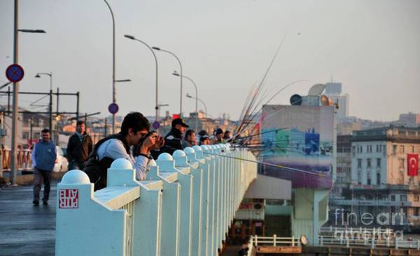 Photograph - Photographer And People Fishing From Bridge Crossing Bosphorus Sea Istanbul Turkey by Imran Ahmed