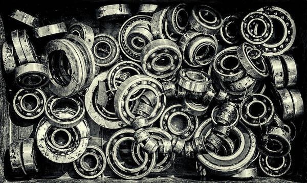 Photograph - Pile Of Old Rusty Ball Bearing Wheels by John Williams