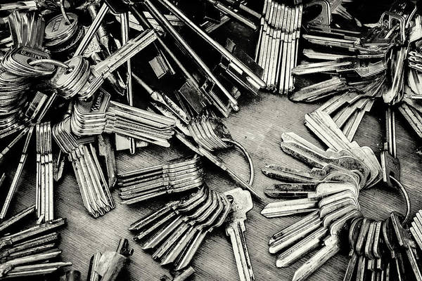 Photograph - Piles Of Blank Keys In Monochrome by John Williams
