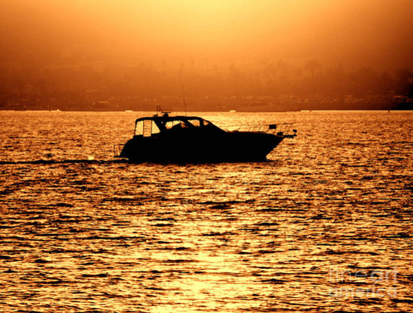 Photograph - Pleasure Craft At Sunset by Olivier Le Queinec